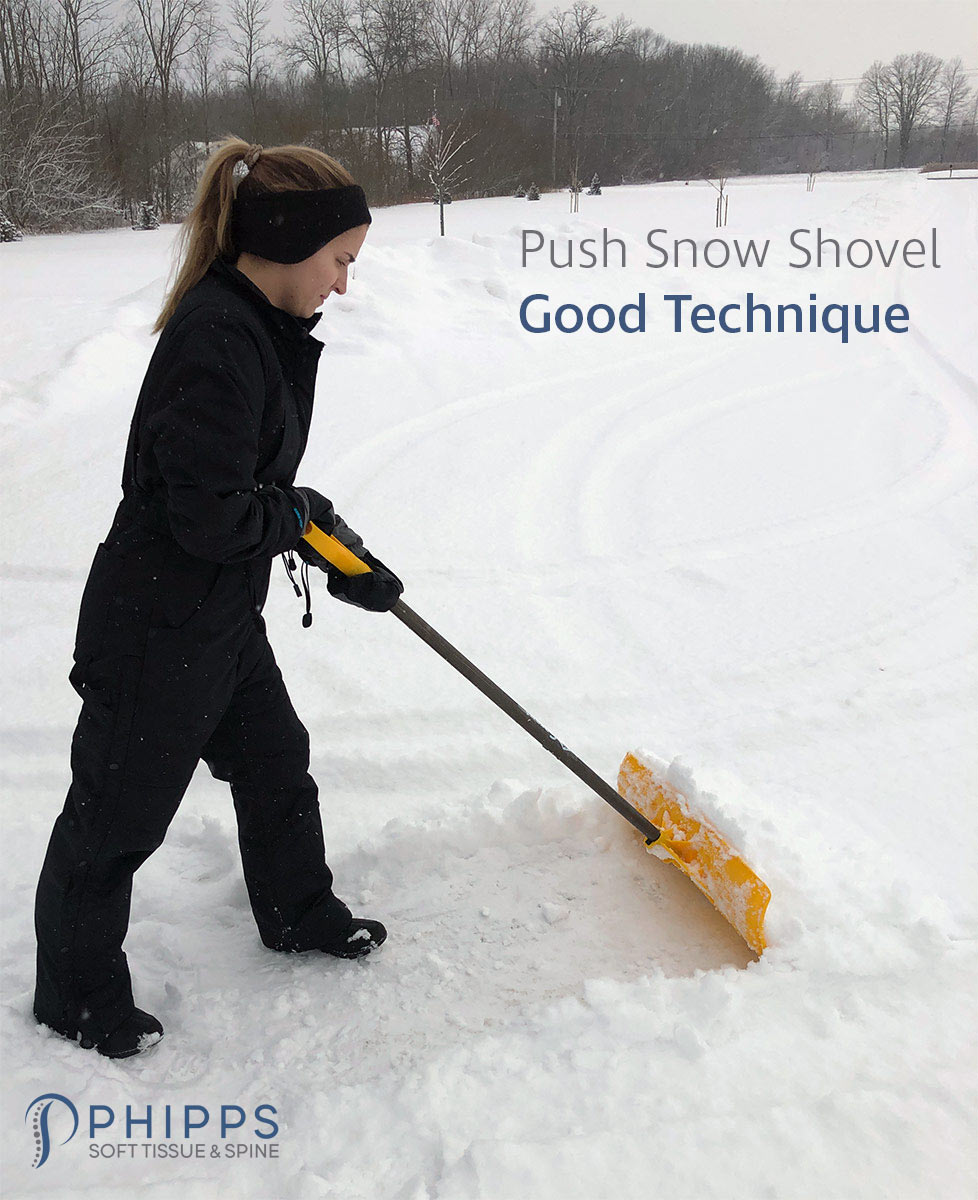 Woman demonstrates good snow shoveling technique with a push snow shovel | Phipps Soft Tissue & Spine